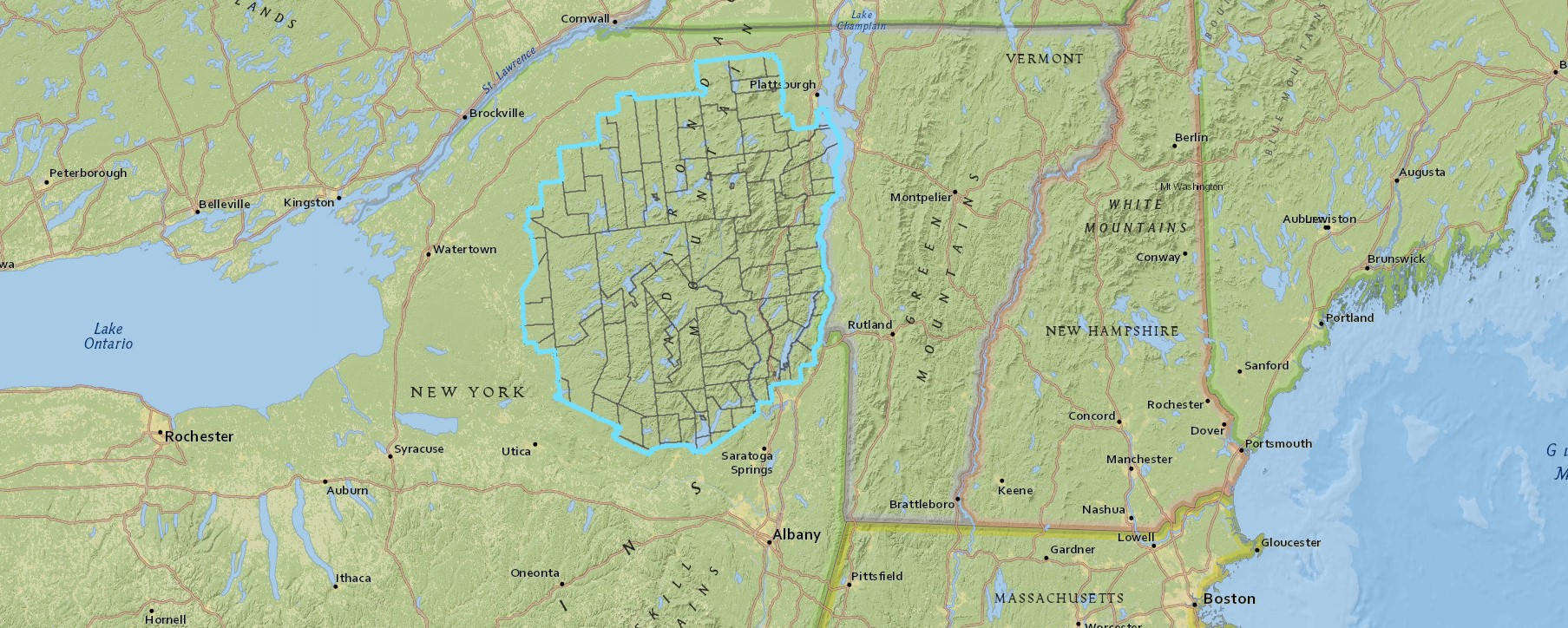 """Map of upstate New York and surrounding states showing the """"Blue Line"""" boundary of the Adirondack Park"""